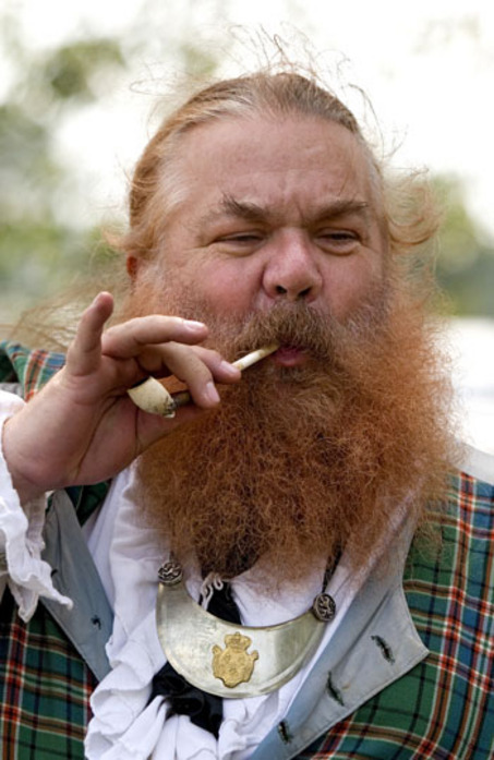 August 23, 2008 Elliot MacFarlane, smokes a pipe while volunteering at the Kalamazoo Scottish Festival at the Kalamazoo County Fairgrounds Saturday. MacFarlane is the founder of MacFarlane's Company, a volunteer organization that uses presentations to teach people about the rich history and culture of Scotland. (Jennifer Harnish / Gazette)