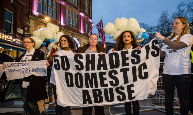 12 Feb 2015, London, England, UK --- London, United Kingdom. 12th February 2015 -- Campaigners against domestic violence demonstrated at the London film premiere of 'Fifty Shades of Grey' in Leicester Square. The film's strong BDSM theme is claimed by the protesters to